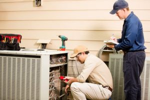 technicians-with-air-conditioner